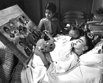 Frida painting while recovering from surgery.