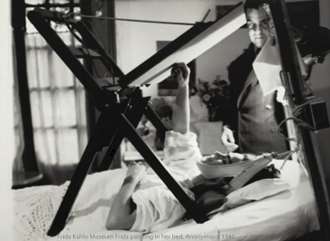 Frida painting while convalescing.