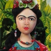 """Marina's Frida Kahlo muse set against detail from Kahlo's """"self portrait with necklace of thorns""""."""
