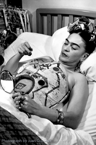 Frida painting her plaster corset in hospital.