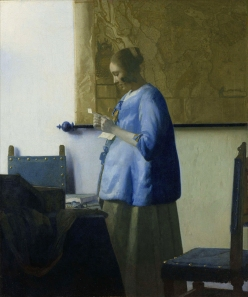A painting by Johannes Vermeer, Woman reading Woman reading a letter, circa 1662-1663.