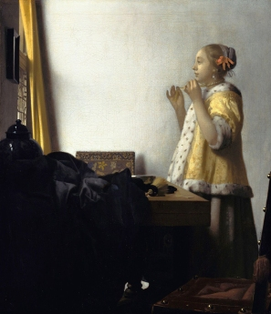 Young Woman with a Pearl Necklace 1664, Vermeer.