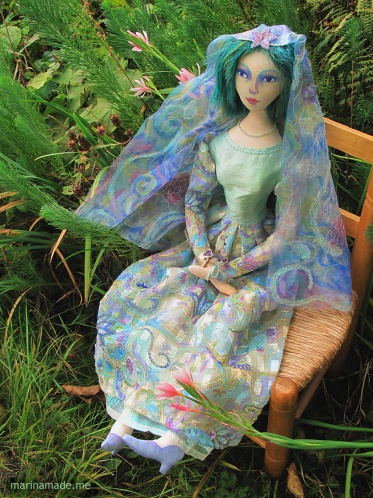 Bella muse, a soft sculpted figurine.