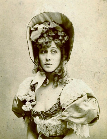 Photograph of Jane Avril wearing a shepherdess bonnet. Photographer unknown.