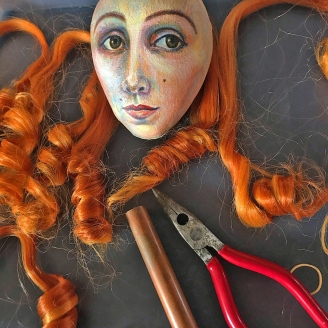 Preparing Jane's coiled ringlets to be stitched onto her painted head.